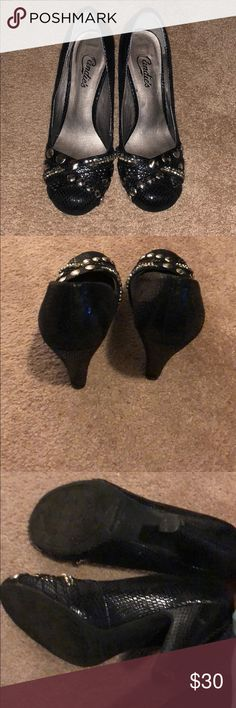 Candies black heels with studs Candies black heels with studs. Good condition. Only worn a couple times.slight mark near bottom of heel in last photo Candie's Shoes Heels