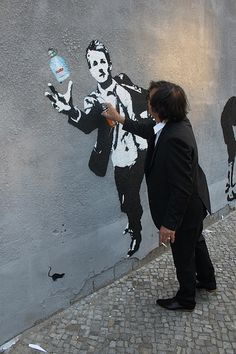 Blek Le Rat putting the final touches on this brand new work for HUGO Create