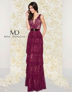 Tiered, lace column gown with v-neck, open back, and velvet belt.