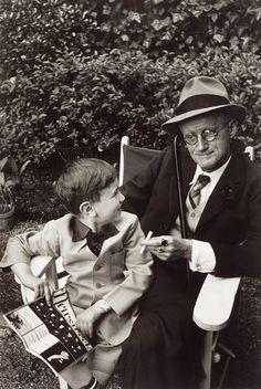 GISÈLE FREUND -  JAMES JOYCE WITH GRANDSON, SITTING ON A BENCH, PARIS (1938)