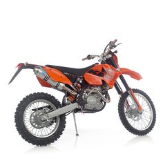 2006 KTM 525 EXC. Bought this for enduro in Colorado. Raced it a few times and rode it all over the front range. A bit heavy but dreamy power.