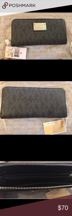 MICHAEL KORS JET SET WALLET BLACK 32F2SJSZ3B-001 MICHAEL KORS JET SET 32FSJSZ3B BLACK ZA CONTINENTAL  ZIP AROUND WALLET WITH SILVER ACCENTS ORDERED ONLINE AND NEVER USED. COMES IN ORIGINAL BOX I RECEIVED IT IN. ONLY TAKEN OUT OF THE BOX TO TAKE PICTURES. Michael Kors Bags Wallets