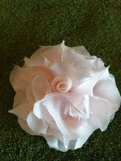 Simply DIY Fabric Flowers I've been working a DIY wall decor project for my guest bathroom. I used a light pink vintage dress (it belonged ...