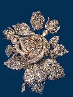 """PRINCESS MATHILDE BONAPARTE DIAMOND ROSE BROOCH~ Created for for Napoleon's niece by Theodore Fester in 1855, the gold-and-silver-setting rose has 250 carats of diamonds. Mathilde ran one of Paris' most distinguished literary and artistic salons. When she died in 1904, the Rose was auctioned and sold by Cartier to Mrs. Cornelius Vanderbilt III, who wore it at the waist or bodice for portraits and other formal occasions in her role as """"Queen of Society."""""""