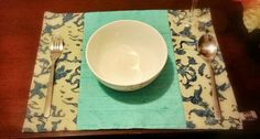 Blue placemat using Cambodian silk and Indonesian batik from BringItHome by Tendance Khmere