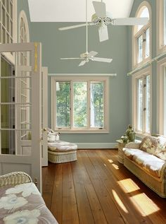 Love this color - sort of like our kitchen walls White trim and accents with warm blue grey wall