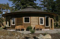 circular building, yurt, round home, mandala home, wood panel round house