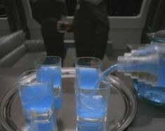 romulan ale (equal parts of vodka, rum and blue curacao or equal parts vodka, triple sec, blue caracao and lemonade)