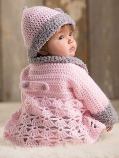 This adorable pink sweater features a plush collar and cuffs crocheted in a contrasting modern light gray for a trendy upgrade in baby styles! With a fashionable matching hat, you can't go wrong with this set for your favorite little one. Designs are.