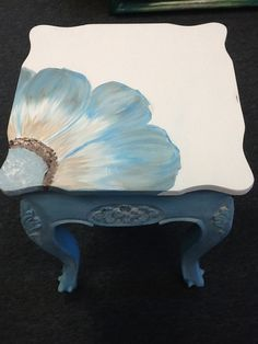Brown table to this great look. Chalk finish with white finish glazed on and multi surface painted flower