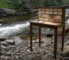 Fly tying desk streamside.  Wouldn't it have been easier just to bring a vise and some materials?