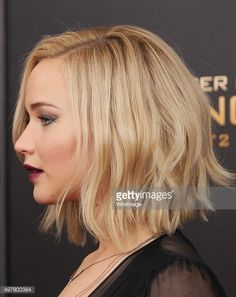 Actress Jennifer Lawrence, hair detail, attends the 'The Hunger Games: Mockingjay- Part 2' New York premiere at AMC Loews Lincoln Square 13 theater on November 18, 2015 in New York City.
