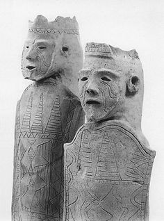 Two men having a shield. They tattoo a face. Tottori Japan. The Kofun period (AD.250-AD.592) art, Haniwa terracotta clay figure.