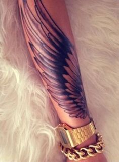 Wing forearm tattoo