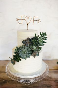 wedding cake with succulent and copper opper