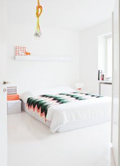 White base with touches of colour here and there. Lovely chevron blanket.