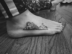 Mountain/waves/sunflower tattoo