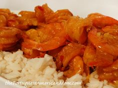 Shrimp Mozambique (Camarão Moçambique) (serves 4-6, dinner —- serves 10-15 party)  2 lbs frozen, deveined, easy peel shrimp (do not remove peel)  1 stick butter  1/2 lg. onion, finely diced  6 garlic cloves, smashed and minced  1 Tbs. crushed red pepper, heaping  1 beer (12 oz)  2 packets Goya Azafran Seasoning  kosher salt to taste