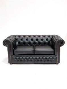 classic solid. Black Chesterfield Sofa Two Seater, www.eventprophire.com