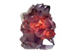 Rich shades of deep purple crystals catch the light and glow beautifully in light in this unique Amethyst Cluster. Shop our highest quality Amethyst lamps