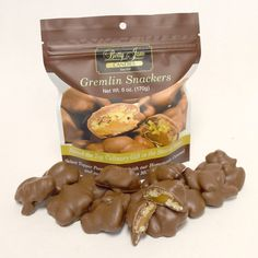 Gremlin Snackers! Our flagship product, People Magazine's Top Culinary Gift In Iowa, now available in a bite size snack! Select Topper Pecans, homemade caramel and our special blend of chocolate. 6oz resealbale snack bag!