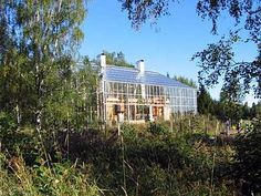 The house-in-a-greenhouse probably wouldn't play very well in say, Arizona, where enclosing your house in glass shell would be folly. But Bengt Warne, a Swedish architect, starting designing what he called the Naturhus (Nature House) in 1976 to work