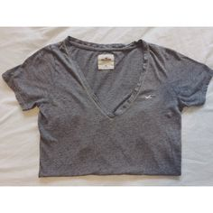 Grey Hollister V Neck Tee Shirt Worn once or twice. Women's size extra small but fits larger. Very comfy and soft. Grey color all around. Hollister brand. Full length v neck t shirt. Free gift with every purchase. Feel free to ask any questions. Bundles (discount) and offers are always welcome. 😘❤ Hollister Tops Tees - Short Sleeve