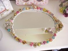Decorated mirror - notice the button and pearl picture frames behind it Love, Love, Love