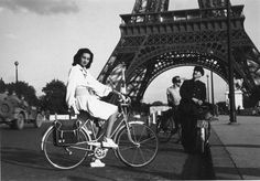 Lee Miller: Fashion Assignment - girl on bike in front of Eiffel Tower, Paris, 1944