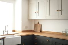 We created the classic shaker style, cosy stone cottage kitchen in a small space while enhancing the feeling of space by splitting the cabinetry colours. Small Cottage Kitchen, Cottage Kitchens, New Kitchen, Home Kitchens, Kitchen Ideas, Kitchen Planning, Small Kitchens, Kitchen Layout, Kitchen Colors