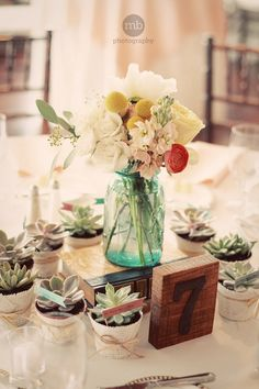 Beautiful Centerpiece and clever--favors incorporated!