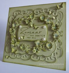 all green with die cuts, dimensional flowers and pearls...lovely...