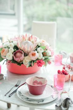 tropical-inspired pink & red floral centerpiece
