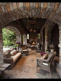 Stonework, wood..close to what I would like for an outdoor living space. Very rustic and comfortable.