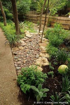 How to Install a Dry Creek Bed: beautiful way to control drainage in landscaping by carole