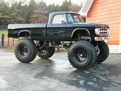 not a Dodge Ram but an older classic lifted Dodge truck