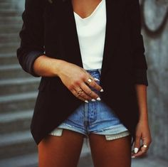 Black blazer, ripped jean shorts, and white top