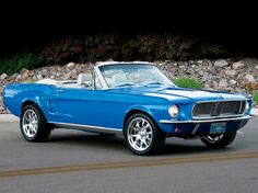 A blue Ford Mustang convertible. Another classic...