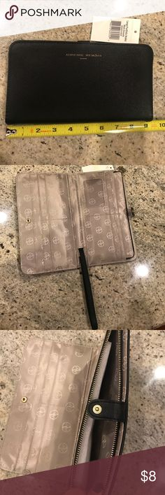 """Adrienne Vittadini portfolio wallet Brand new portfolio wallet with a pull-out wristlet strap. Separate pocket with zipper. Button closure. Outside pocket with zipper. 9"""" x 5"""" Bags Wallets"""