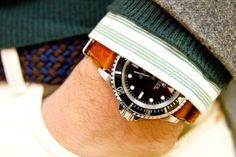 Rugged leather NATO strap on Rolex Submariner watch for casual look.