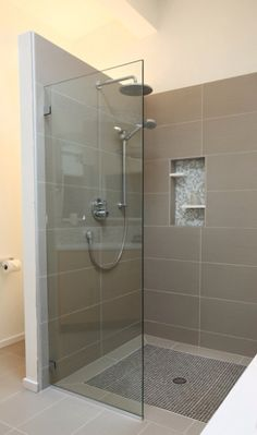 Larger wall tile with inset shelves and small mosaic tile details