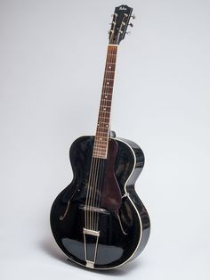 "1930 Gibson Black L-10 in excellent condition.  The L-10 model was clearly in development for sometime at the Gibson factory before being listed as a catalog model.  Examples as early as 1925 exist and are well documented.  The first year the L-10 appears in the catalog is 1932. Gibson archtop guitars are forever the bench mark to which all others are measured.  This guitar is a perfect example why.  Included is the original red-line ""faultless"" case which is also in excellent condition."