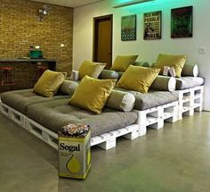 Pallet stadium seating on a converted theater room. This would be a brilliant temporary way to watch a big game or have a slumber party when company visited!