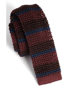 Burberry Prorsum Horizontal Stripe Knit Silk Tie The most traditional knit ties are made of silk, followed by wool and then cotton, and what makes this Burberry one incredibly modern, but just as sophisticated, is the fact that it's slimmer and has this wonderful stripe pattern. It really marries beautifully with a pinstripe suit or a fall tweed sports jacket. Put it with a chambray shirt, put it with a white oxford, put it with anything.