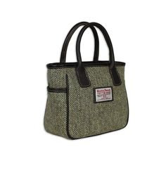 Available in selected Harris Tweed Hand woven from 100% virgin wool Leather Trim Suede effect lining Interior small zip pocket 25cm (W) x 19cm (H) x 10cm (D...