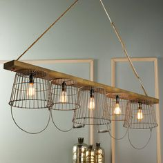 Rustic Wire Basket and Wood Chandelier To market, to market! Wood, wire, and rope form a unique chandelier with inspiration from market baskets and rope swings! A great kitchen island chandelier or use over a rustic table. Wire Basket Chandelier, Rustic Chandelier Lighting, Chandelier Shades, Home Lighting, Lighting Design, Chandelier Ideas, Contemporary Chandelier, Wooden Chandelier, Cabin Lighting