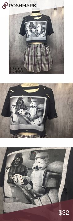 """STAR WARS OFFICIAL DISTRESSED GEMSTONE CROP TOP!! STAR WARS OFFICIAL DISTRESSED GEMSTONE CROP TOP!! HILARIOUS POKER FACE PARODY TEE! Darth Vader playing poker with storm troopers with the Death Star looming in the back! Red gemstone details on front with heavy distressing all over! Graphic and fabric has started to age looking perfectly vintage! 100 % COTTON! Can be styled sooo many ways! MEASUREMENTS - BUST: 17.5"""" / LENGTH: 15"""" #festival #concert #grunge #summer #date #band Star Wars Tops…"""
