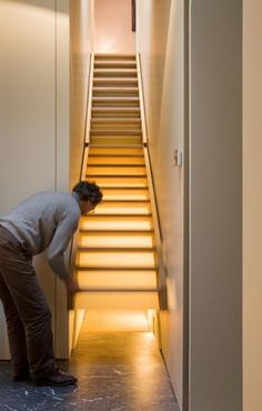 A staircase that opens up. Looks like it leads to another hallway!