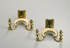 American, brass pair of jamb hooks with backplates circa 1800