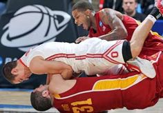 Image: Ohio State Buckeyes guard Aaron Craft battles for a loose ball on top of Iowa State Cyclones forward Georges Niang while guard Korie Lucious assists during the NCAA tournament at University of Dayton Arena on Sunday (©  Brian Spurlock-USA TODAY Sports)